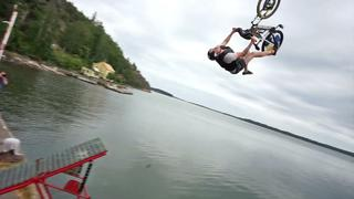 Crazy bike jump into whater